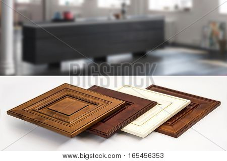 Wooden kitchen cabinet doors made from maple. Traditional, modern and contemporary style.  Isolated close up. Background blurry.