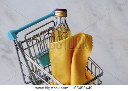 Bottle of whiskey draped in a yellow cloth in a trolley.