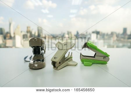 staple remover and stapler set on table