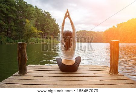 Woman do yoga outdoor. Woman exercising yoga at the nature background select focus