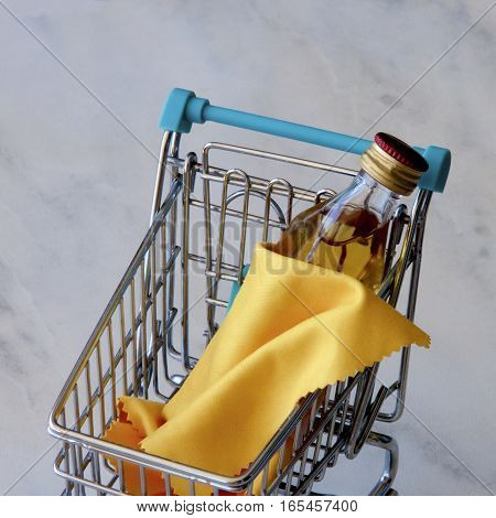 Bottle of whiskey draped in a shopping cart.