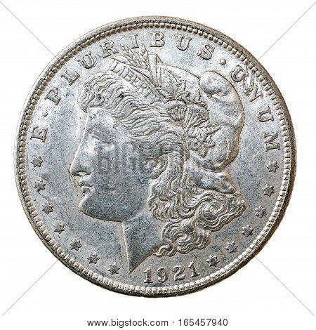 A macro shot of a 1921 Morgan Dollar coin obverse.