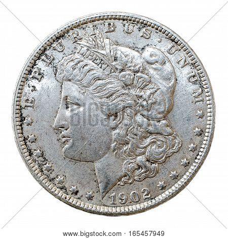A macro shot of a 1902 Morgan Dollar silver coin obverse.