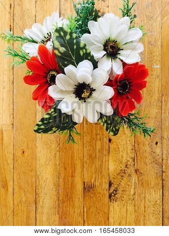white and red bouquet of flower on wood table top view