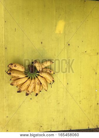 Banana with yellow background top view classic vintage