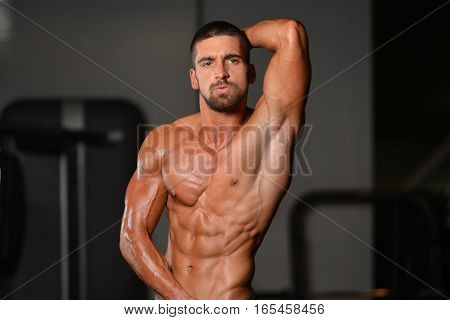 Young Man Showing Abdominal Muscle