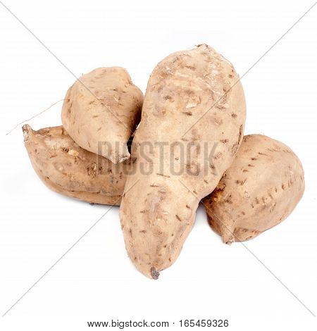 Some sweet potatoes isolated on white background.