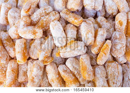 Background of typical sicilian cookies made with orange and almond paste.