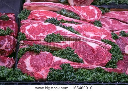 Meat for sale on display in a butcher's section of a grocery store.