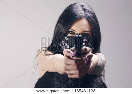 Beautiful Brunette Woman With A Pistol Pointing To Camera.