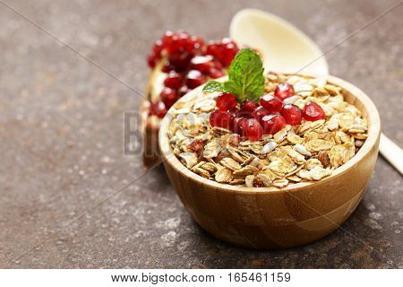 Natural wholegrain muesli with pomegranate for a healthy breakfast