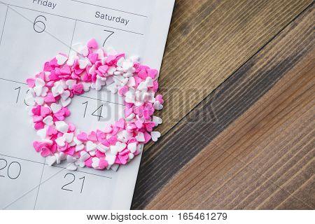 Heart Shave Sprinkles Round Valentine Date on Calendar with Wooden Background