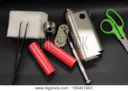 blurred background Vape E-cigarette vaping mechanical mod liquid a series of images