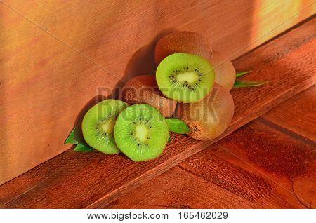 Kiwi On Brown Wooden Background