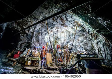 Gold mining underground. Digging though the tunnel.