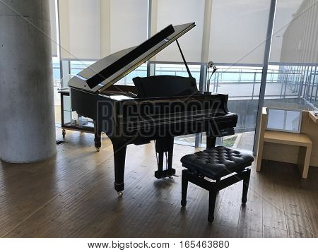 A beautiful grand piano in a room.
