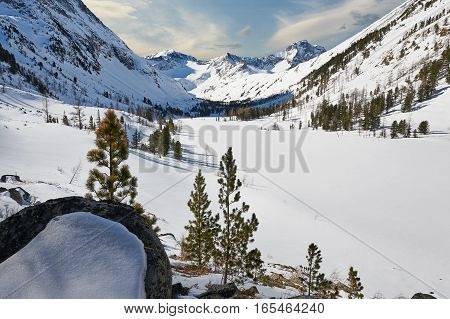 Beautiful winter landscapethe harsh cold winter Altai Severe mountains peaks covered by snow Beautiful fresh snow. Russia Siberia Altai mountains.
