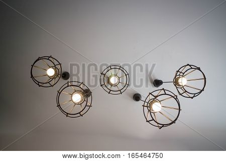 Vintage hanging light bulb over grey room stock photo