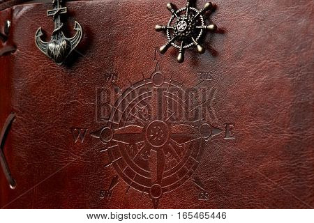 Closeup of brown leather book  ship cover with compass