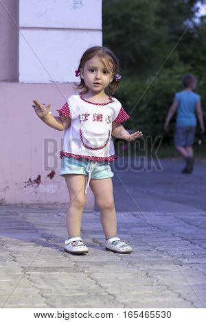 Little baby girl with pigtails making the stop hand gesture