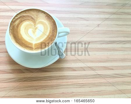 cup of latte coffee in morning on cream laminate table