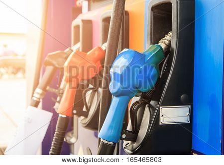 Fuel nozzle dispensing pump at gas station. The power concept.