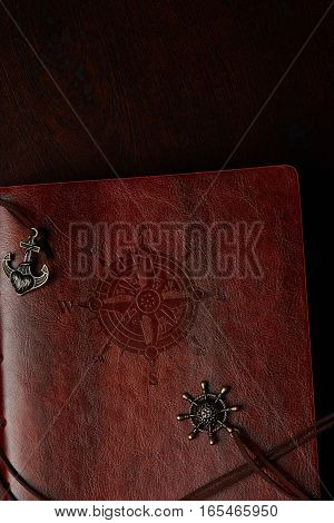 Leather travel diary with sea travel compass decoration