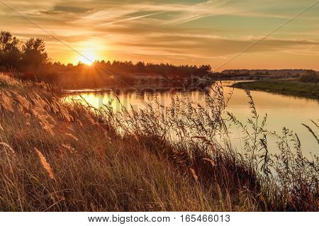 Landscape With The River And The Sunset Over The River In The Countryside