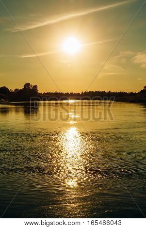 Sun In The Hour Of The Evening On The River