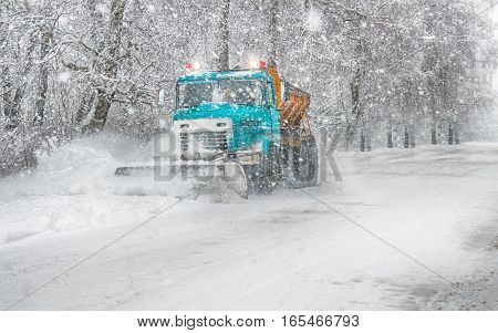 snow plow doing snow removal during blizzard