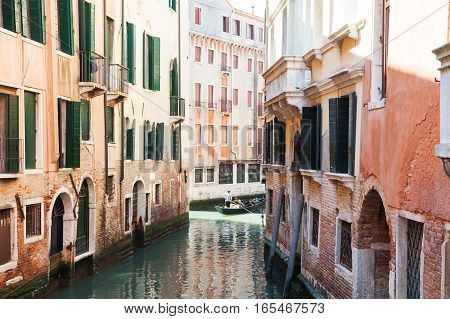 Scenic Canal With Ancient Buildings In Venice, Italy