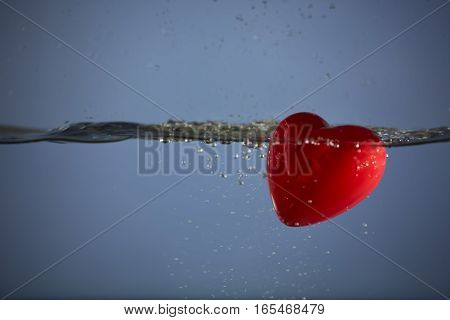 Valentine heart diving into love with a splash