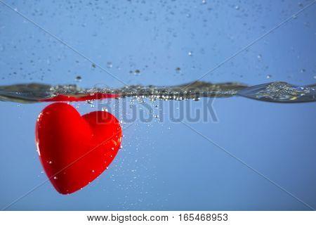 Heart splashing in water as a playful romantic gesture