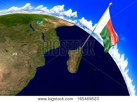 Madagascar national flag marking the country location on world map. 3D rendering, parts of this image furnished by NASA