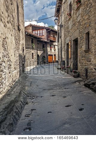 Spain Catalonia . Rupit - mountain village built on top of the basalt rocks in the national park of volcanic origin. Covering many ancient streets - frozen lava.