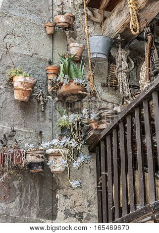 Spain Catalonia . Rupit - medieval mountain village built on top of the basalt rocks in the national park of volcanic origin. The colorful balconies locals.