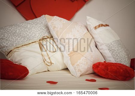Romantic interior pillows with flower pattern. Stock photo