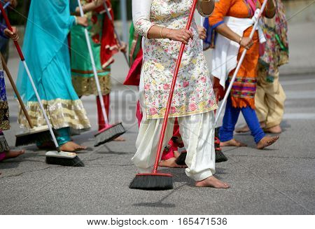 Many Barefoot Women Sweep The Road During The Ceremony Along The