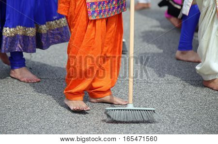 Barefoot Women Of Sikh Religion With Colorful Clothes Sweep The