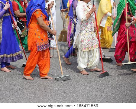 Barefoot Women  Sweep The Road During The Celebration Along The