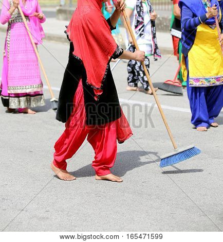 Barefoot Women Of Sikh Religion With Clothes Of Many Colors Swee