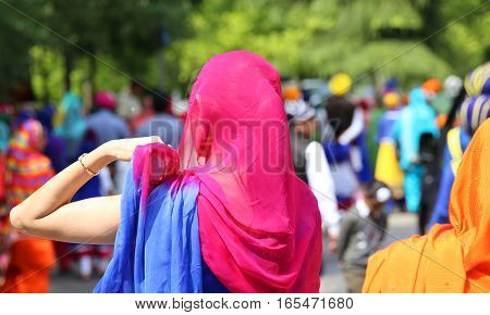 Woman With Headscarves During The Event In The City