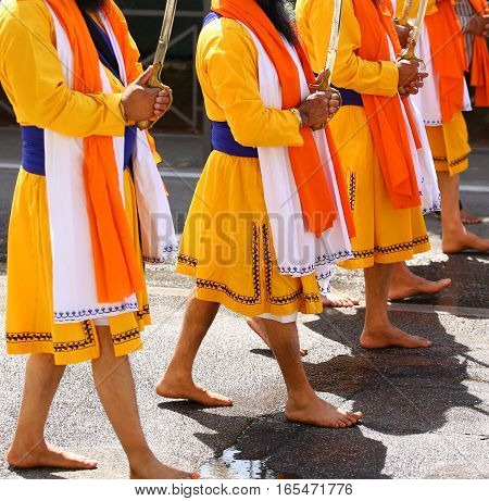 Sikh Men Walk Barefoot Through The Streets