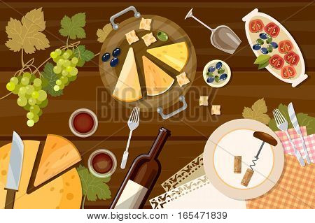Wine and cheese tasting top view wine bottle and grapes on wooden table