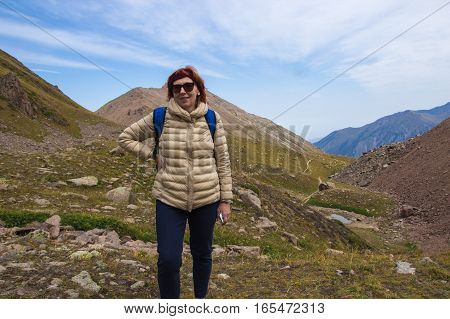 Aged Sport Woman In Sunglasses At Talgar Pass, Tien Shan Mountains Near Shymbulak Ski Resort, Almaty