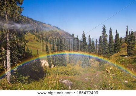 Rainbow At Tuyk Su Gorge Near Shymbulak Ski Resort. Tien Shan Mountains At Summer Time, Almaty, Kaza
