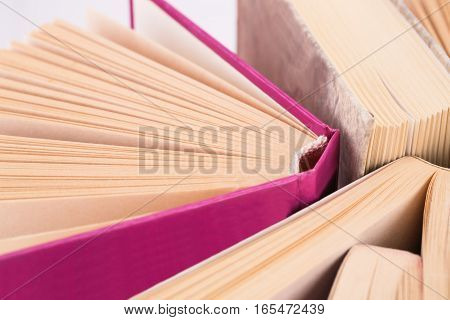 Many opened books horizontal close up picture.