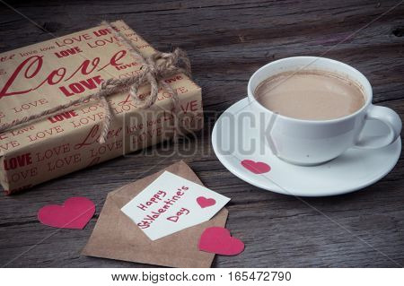 Note Happy St. Valentine's Day  With  Gift And Cup Of Coffee On Wooden Background