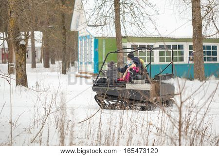 Gomel, Belarus - January 15, 2017: Country Winter Family Holiday. Riding All-terrain Vehicle In The