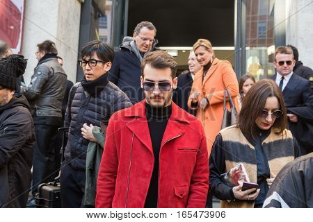 MILAN ITALY - JANUARY 15: Fashionable people outside Ferragamo fashion show building during Milan Men's Fashion Week on JANUARY 15 2017 in Milan.